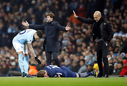 Tottenham Hotspur's Harry Kane lies on the floor after a collision with Manchester City's Nicolas Otamendi (left) during the Premier League match at the Etihad Stadium, Manchester.