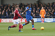 AFC Wimbledon defender Deji Oshilaja (4) battles for possession with Northampton Town forward Sam Hoskins (14) during the EFL Sky Bet League 1 match between AFC Wimbledon and Northampton Town at the Cherry Red Records Stadium, Kingston, England on 10 February 2018. Picture by Matthew Redman.