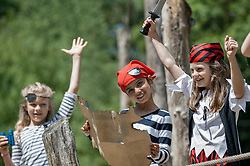 Girls playing on pirate ship in adventure playground, Bavaria, Germany