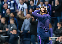 Football - 2019 / 2020 Premier League - Tottenham Hotspur vs. Watford<br /> <br /> Mauricio Pochettino, Manager of Tottenham FC, hold his head in his hands as the final whistle goes at The Tottenham Hotspur Stadium.<br /> <br /> COLORSPORT/DANIEL BEARHAM