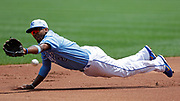 Kansas City Royals shortstop Alcides Escobar is unable to grab a RBI single hit by Houston Astros' Yuli Gurriel in the first inning of a baseball game at Kauffman Stadium in Kansas City, Mo., Sunday, June 17, 2018. (AP Photo/Colin E. Braley)