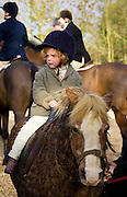 Young girl riding her pony, Nether Westcote, Oxfordshire, United Kingdom