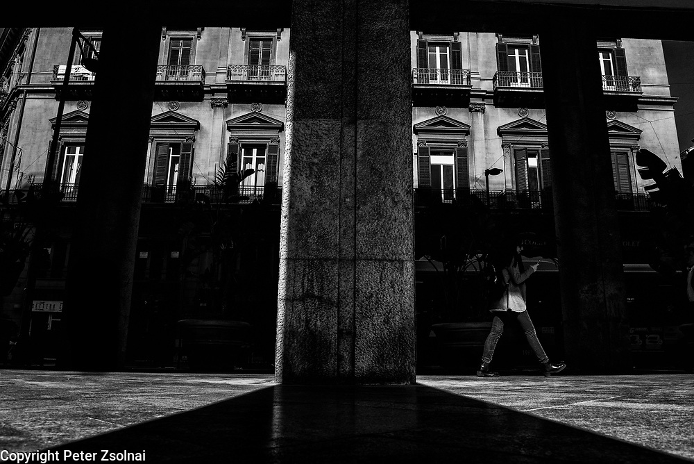 Passanger walks by in an Alley in Palermo, Sicily , Italy
