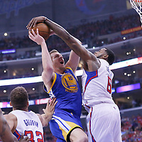 21 April 2014: Los Angeles Clippers center DeAndre Jordan (6) blocks Golden State Warriors forward David Lee (10) during the Los Angeles Clippers 138-98 victory over the Golden State Warriors, during Game Two of the Western Conference Quarterfinals of the NBA Playoffs, at the Staples Center, Los Angeles, California, USA.