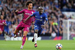 30 September 2017 - Premier League Football - Chelsea v Manchester City - N'Golo Kante of Chelsea pulls ahead of Leroy Sane of Man City - Photo: Charlotte Wilson / Offside