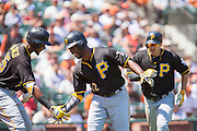 Pittsburgh Pirates center fielder Andrew McCutchen (22) celebrates his home run with Pittsburgh Pirates right fielder Gregory Polanco (25) against San Francisco Giants starting pitcher Matt Cain (18) in the fifth inning at AT&T Park in San Francisco, Calif., on August 17, 2016. (Stan Olszewski/Special to S.F. Examiner)