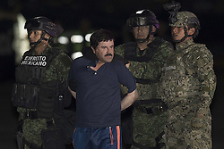 MEXICO Mexico City, Jan. 9, 2016 (Xinhua) -- Soldiers escort Joaquin Guzman Loera, alias ''El Chapo'', upon his arrival to the hangar of the Attorney General's Office, in Mexico City, capital of Mexico, on Jan. 8, 2016. After an early morning raid in northwestern Mexico's Sinaloa State's town of Los Mochis by Mexican police and marines on Friday, Sinaloa Cartel leader Joaquin Guzman Loera was recaptured, six months after his second prison break. (Xinhua/Alejandro Ayala) (Credit Image: © Pedro Mera/Xinhua via ZUMA Wire)