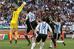 03.07.2010, CAPE TOWN, SOUTH AFRICA,  Goalkeeper Manuel Neuer ( FC Schalke 04 #01 ) of Germany punches clear of Martin Demichelis of Argentina attempted header during the Quarter Final, Match 59 of the 2010 FIFA World Cup, Argentina vs Germany held at the Cape Town Stadium EXPA Pictures © 2010, PhotoCredit: EXPA/ nph/  Kokenge