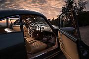 Image of a 1955 jade Metallic Green Pre A Porsche 356 tan interior at sunset, Santa Barbara, California, America west coast by Randy Wells