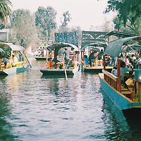 1. When was this photo taken?<br /> <br /> January 2015<br /> <br /> 2. Where was this photo taken?<br /> <br /> Xochimilco Mexico City, Mexico<br /> <br /> 3. Who took this photo?<br /> <br /> James Leyba<br /> <br /> 4. What are we looking at here?<br /> <br /> Boats floating on Xochimilco's historic canals, where vegetables and flowers have been grown for centuries, supporting the Mexico CIty economy.<br /> <br /> 5. How does this old photo make you feel?<br /> <br /> Seeing this photo brings me right back to Xochimilco and a trip that presented so many great surprises - wonderful food, people, and destinations seems cliche. I met my future wife on this trip, made new lifelong friends, and found myself wondering why I'd never considered Mexico as destination before.<br /> <br /> 6. Is this what you expected to see? <br /> <br /> Yes.<br /> <br /> 7. What kind of memories does this photo bring back?<br /> <br /> I met my future wife on this trip. I can't wait to go back.<br /> <br /> 8. How do you think others will respond to this photo? <br /> <br /> Hopefully intrigued by what looks like a great experience.