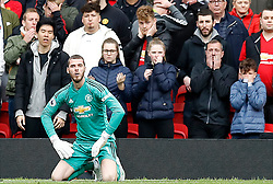 File photo dated 28-04-2019 of Manchester United goalkeeper David de Gea sits dejected after Chelsea's Marcos Alonso (not pictured) scores his side's first goal of the game during the Premier League match at Old Trafford, Manchester.
