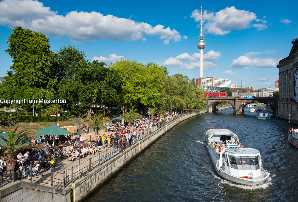 Outdoor riverside bar in Monbijoupark  beside Spree River in summer in Berlin, Germany