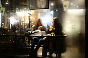 Girls sip on Frappuccinos in Starbucks on Oxford Street