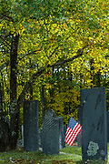 American flag and old cemetery headstones,  afternoon light, October, Hillsborough County, Hancock, New Hamphshire, USA