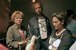 29 August, 2005. New Orleans, Louisiana.<br /> Hurricane Katrina hits New Orleans. Mayor Ray Nagin and top city councillors listen to the latest reports coming in from the emergency services. As levees are breached and flooding begins to swamp the city, mayor Ray Nagin and his aides at the Hyatt Hotel appear helpless as they struggle to maintain communications, command and control in a city rapidly losing control.<br /> Photo; Charlie Varley.