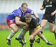 Shepards Bush, West London, UK., 30.09.2001, Joe WOLSEY tackled,  London Wasps vs Stade Francais, Loftus Road Stadium,<br /> Heineken European Rugby Cup,<br /> [Mandatory Credit: Peter Spurrier/Intersport Images],