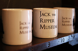 © Licensed to London News Pictures. 04/10/2015. London, UK. Coffee mugs from Jack the Ripper Museum are displayed for sale.  A planned protest was cancelled at the museum today. Photo credit: Peter Macdiarmid/LNP