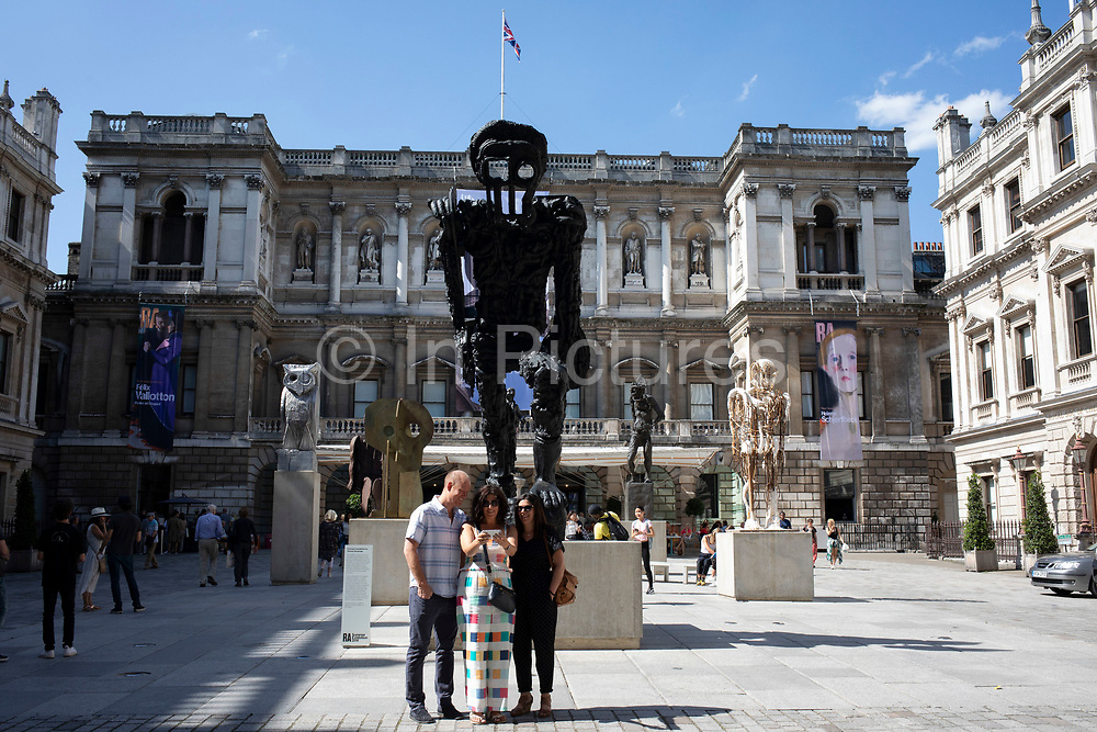 People outside the entrance to the Royal Academy for the Summer Show in London, United Kingdom. The Summer Exhibition is an open art exhibition held annually by the Royal Academy in Burlington House, Piccadilly in central London, England, during the months of June, July, and August. The exhibition includes paintings, prints, drawings, sculpture, architectural designs and models, and is the largest and most popular open exhibition in the UK. It is also the longest continuously staged exibition of contemporary art in the world.