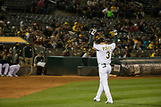 Oakland Athletics third baseman Trevor Plouffe (3) reacts to a strike out against the Miami Marlins at Oakland Coliseum in Oakland, Calif., on May 23, 2017. (Stan Olszewski/Special to S.F. Examiner)