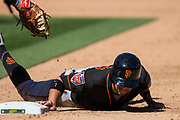San Francisco Giants left fielder Gorkys Hernandez (7) dives into first base during a pick off attempt by the Oakland Athletics at Oakland Coliseum in Oakland, California, on March 25, 2018. (Stan Olszewski/Special to S.F. Examiner)