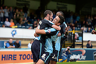 Michael Harriman of Wycombe Wanderers celebrates after  scoring his sides first goal to make it 1-0 with Luke O'Nien of Wycombe Wanderers and his team. Skybet football league two match, Wycombe Wanderers v Hartlepool Utd at Adams Park in High Wycombe, Bucks on Saturday 5th Sept 2015.<br /> pic by John Patrick Fletcher, Andrew Orchard sports photography.