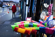 Exterior of colourful floor brushes for sale outside a shop on Ladypool Road on 10th December 2020 in Birmingham, United Kingdom. This area is predominantly inhabited by Asian families. Sparkbrook has the second highest non-white population in Birmingham, with minority ethnic residents living in the area; notably it is home to a large Somali population. Sparkbrook is also the location of Birminghams Balti Triangle, as many of the residents have their own balti businesses.