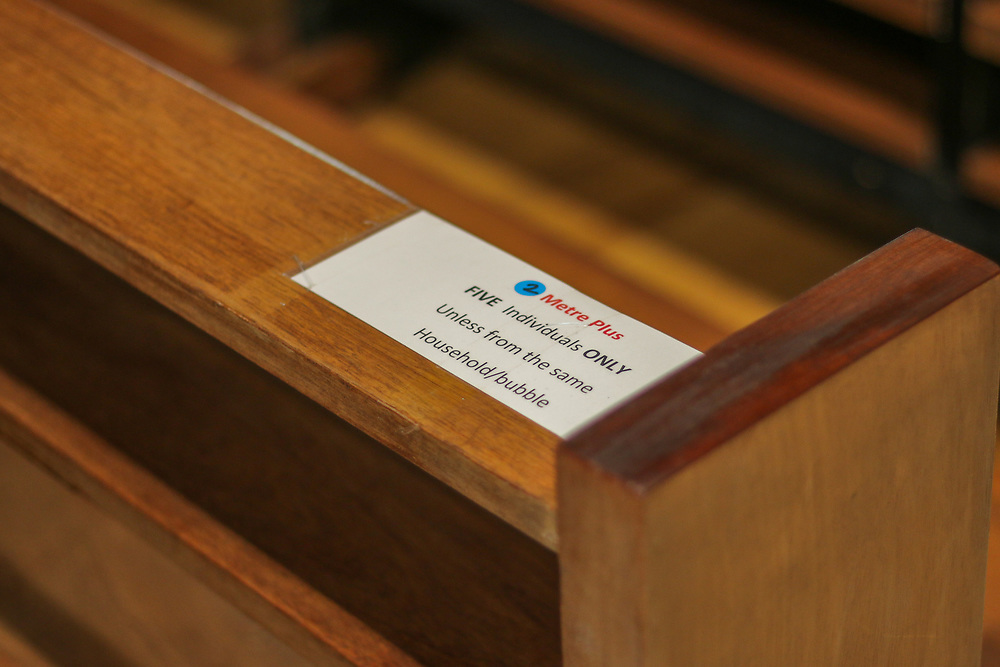 28th February, Cheltenham, England. A sign on a pew at St Gregory's Catholic Church in Cheltenham advises the congregation to practice social distancing.