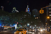 The Empire State Building lit in red, white and blue for election night, November 6, 2012, seen from the Avenue of the Americas (6th Avenue) over Bryant Park.