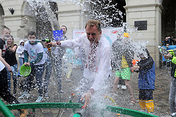 April 30, 2019 - Lviv, Ukraine - City Head of Lviv Andrii Sadovyi is pictured with a water hose during the Pouring Monday festivities at the Market Square of Lviv, western Ukraine, April 29. 2019. Ukrinform. /VVB/ (Credit Image: © Markiyan Lyseiko/Ukrinform via ZUMA Wire)