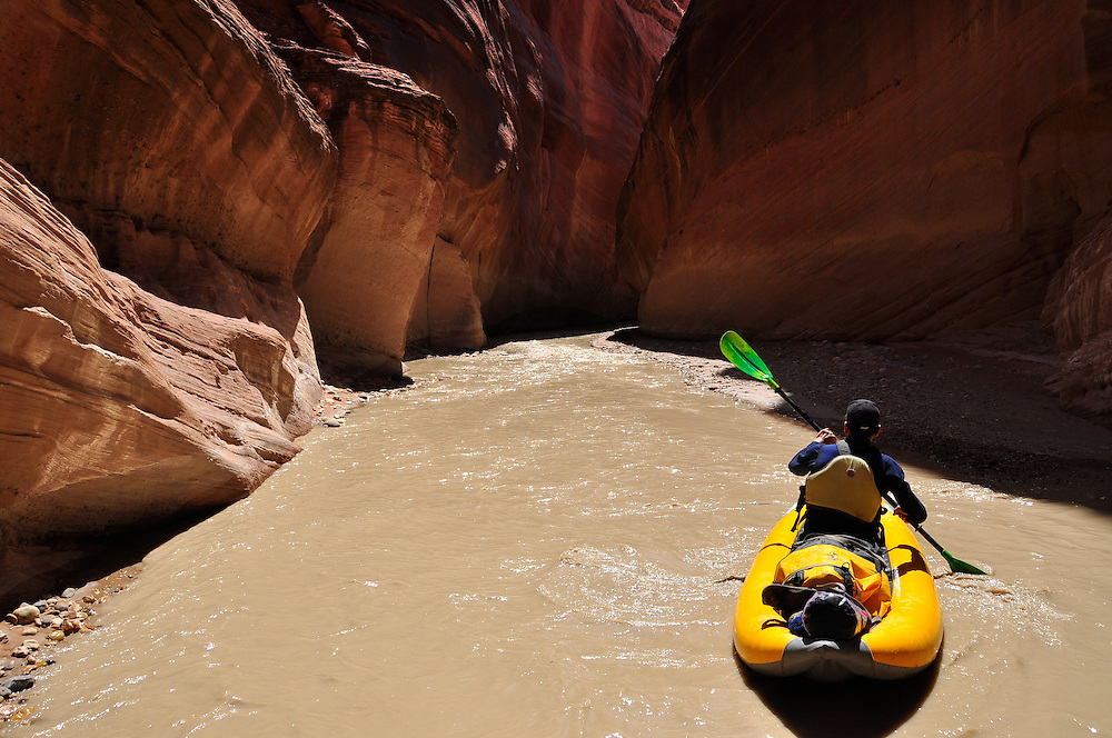Inflatable kayaker on Utah's Paria River.