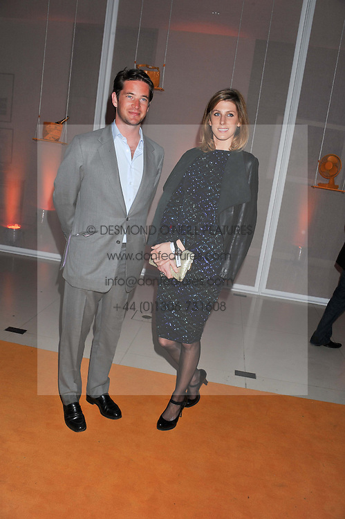 The HON.JAMES TOLLEMACHE and SUSANNA WARREN at the Veuve Clicquot Experience at The Hurlingham Party following the Polo in The Park held at the Hurlingham Club, London SW6 on 8th June 2012.