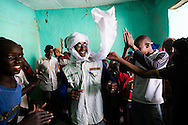 Youths dance in the looted shop of an Arab merchant in an improvised disco in the center of Timbuktu on Feb. 1, 2013 after months of music being banned.
