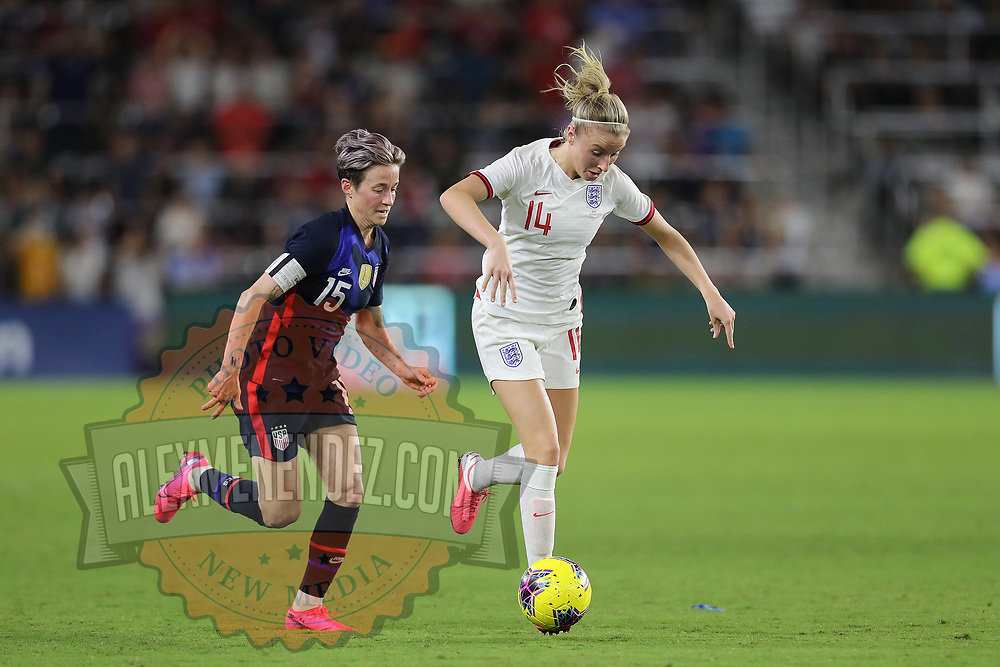 England defender Leah Williamson (14) runs past the United States forward Megan Rapinoe (15) during the first match of the 2020 She Believes Cup soccer tournament at Exploria Stadium on 5 March 2020 in Orlando, Florida USA.