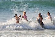 Summer vacation concept. Splashing in the sea. Photographed in the Mediterranean Sea, Tel Aviv, Israel