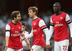 Arsenal's Mathieu Flamini lets Arsenal's Nacho Monreal and Arsenal's Yaya Sanogo know what he thinks - Photo mandatory by-line: Matt Bunn/JMP - Tel: Mobile: 07966 386802 16/02/2014 - SPORT - FOOTBALL - Emirates Stadium - London - Arsenal v Liverpool - FA Cup - Fifth Round