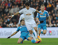 Swansea City's Nelson Oliveira is tackled by Sunderland's Jordi Gomez<br /> <br /> Photographer Ashley Crowden/CameraSport<br /> <br /> Football - Barclays Premiership - Swansea City v Sunderland - Saturday 7th February 2015 - Liberty Stadium - Swansea<br /> <br /> © CameraSport - 43 Linden Ave. Countesthorpe. Leicester. England. LE8 5PG - Tel: +44 (0) 116 277 4147 - admin@camerasport.com - www.camerasport.com