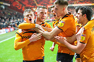 Hull City forward Keane Lewis-Potter (31 ) celebrates with teammates after scoring a goal (2-2) during the EFL Sky Bet Championship match between Charlton Athletic and Hull City at The Valley, London, England on 13 December 2019.