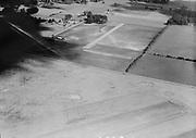 """Ackroyd 06923-1. """"Johny Inman. Aerial of Hillsboro Airport. showing Lee Hoffman air strip in background. June 11, 1956"""" (5x7"""")"""
