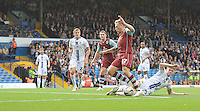 Burnley's Scott Arfield avoids the challenge from Leeds United's Sam Byram before shooting past Leeds United's goalkeeper Paddy Kenny for the opening goal of the match<br /> <br /> Photo by Stephen White/CameraSport<br /> <br /> Football - The Football League Sky Bet Championship - Leeds United v Burnley - Saturday 21st September 2013 - Elland Road - Leeds<br /> <br /> © CameraSport - 43 Linden Ave. Countesthorpe. Leicester. England. LE8 5PG - Tel: +44 (0) 116 277 4147 - admin@camerasport.com - www.camerasport.com
