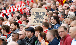 A Liverpool fan holds a sign pleading Liverpool's Philippe Coutinho to stay during the Premier League match at Anfield, Liverpool.