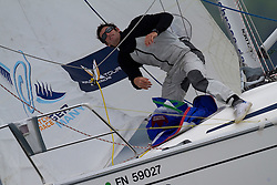 Team Proximo bowman Adam Martin during a spinnaker drop on day 1 of Match Race Germany. World Match Racing Tour.  Langenargen, Germany. 20 May 2010. Photo: Gareth Cooke/Subzero Images/WMRT
