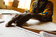 Vaccination team leader N'Faly Samaka points at vaccination records at the Kita reference health center in the town of Kita, Mali on Monday August 30, 2010.