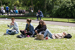 © Licensed to London News Pictures. 14/05/2014. London, UK. People enjoying the sunshine and good weather in Regents Park in London on 14th May 2014. Photo credit : Vickie Flores/LNP