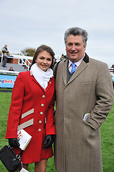 Trainer PAUL NICHOLLS and his daughter MEGAN NICHOLLS at the Hennessy Gold Cup at Newbury Racecourse, Berkshire on 26th November 2011.