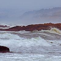 Waves break along the Pacific Ocean coast near Pescadero, California.