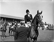"02/08/1960<br /> 08/02/1960<br /> 02 August 1960<br /> R.D.S Horse Show Dublin (Tuesday). Miss Pat Smythe on ""Flanagan"" winner of the International Jumping competition receives  her rosette from Baron R. de Soultrait (F.E.Q.) at the Dublin Horse Show."