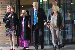 London, May 19th 2014. Rolf Harris leaves Southwark Crown Court after another day of his trial on 12 counts of indecent assault, accompanied by his niece Jenny, left, his wife Alwen and his daughter Bindi, right.
