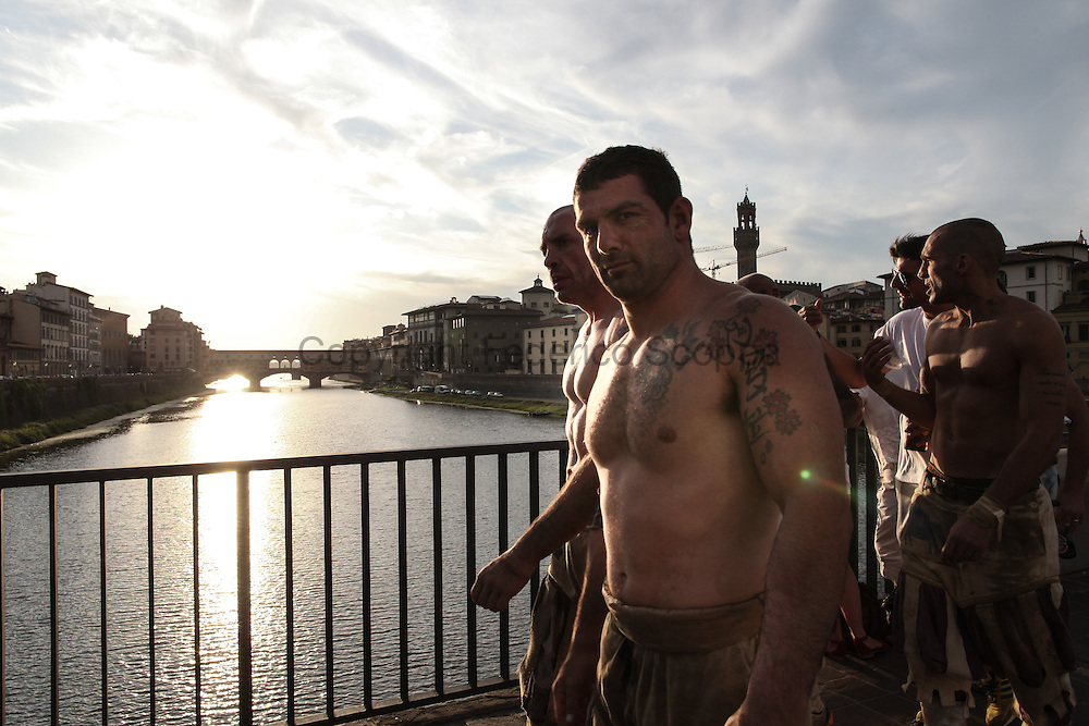 The Bianchi team walking the street of Florence going back to their district, Santo Spirito. The ponte Vecchio on the background
