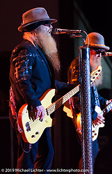 Dusty Hill of ZZ Top play on the Wolfman Jack stage at the Buffalo Chip Campground during the annual Sturgis Black Hills Motorcycle Rally. SD, USA. August 6, 2014.  Photography ©2014 Michael