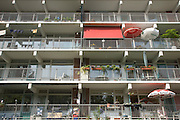 parasols on the balcony of a flat building